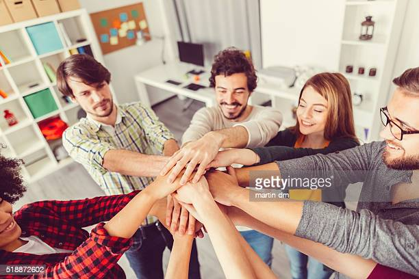Colleagues high fiving in the office