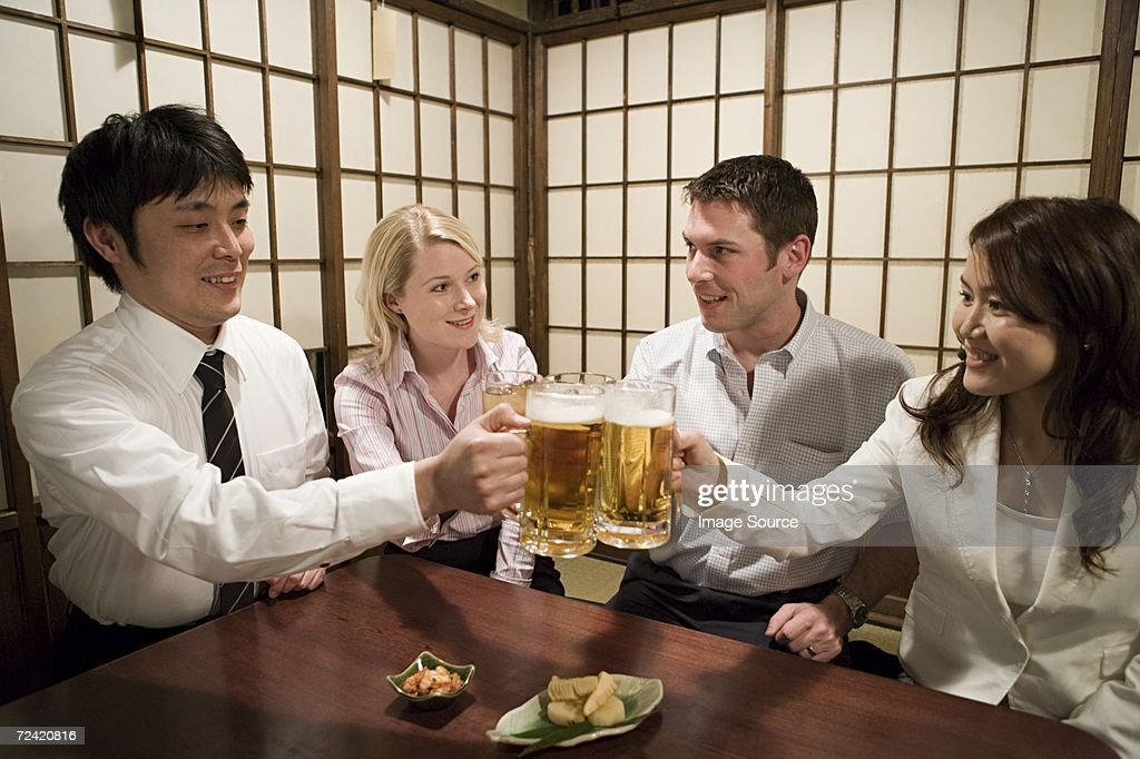 Colleagues in a bar : Stock Photo