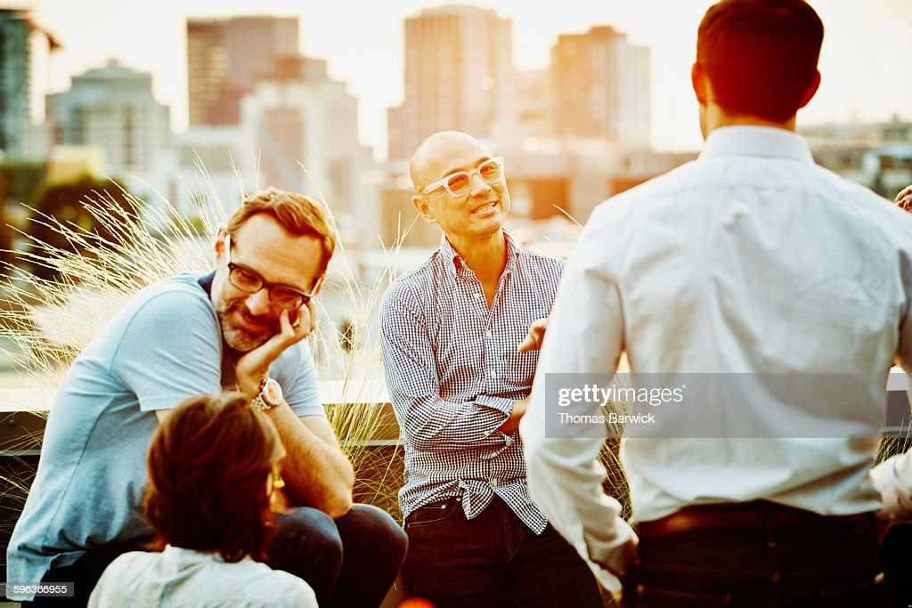 Colleagues in discussion on office terrace : Stock Photo