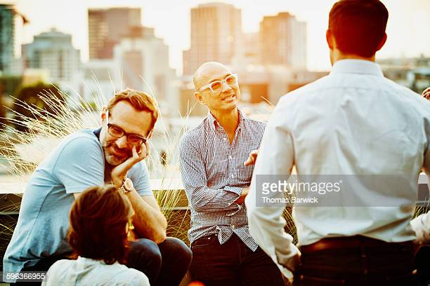 Colleagues in discussion on office terrace