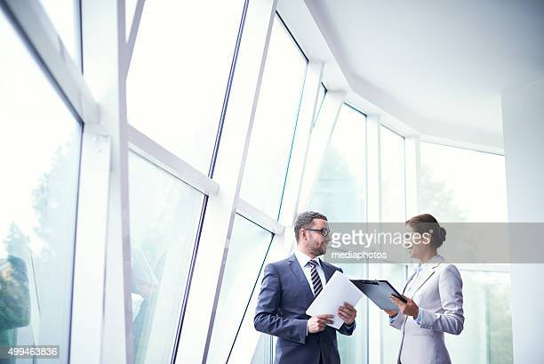 colleagues in office building - business finance and industry stock pictures, royalty-free photos & images