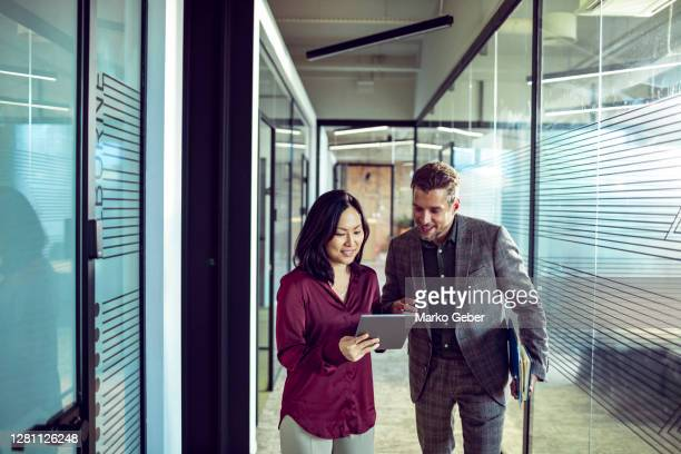 colleagues in the hallway - business stock pictures, royalty-free photos & images