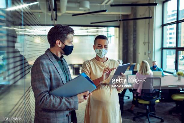 colleagues in the office - business stock pictures, royalty-free photos & images