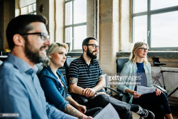 Colleagues listening during a casual business meeting