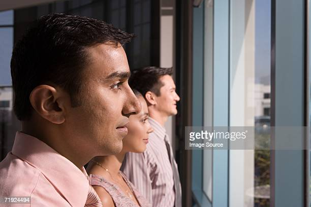 Colleagues looking out of window