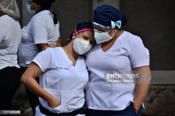 Colleagues mourn during the funeral of a male nurse of the Honduran Institute of Social Security who died from COVID19 in Tegucigalpa on August 6...