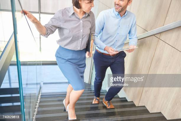 Colleagues on stairway chatting