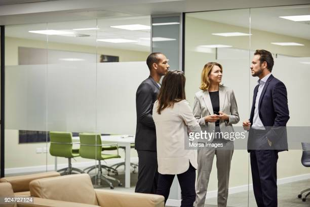 colleagues planning strategy against board room - four people stock pictures, royalty-free photos & images
