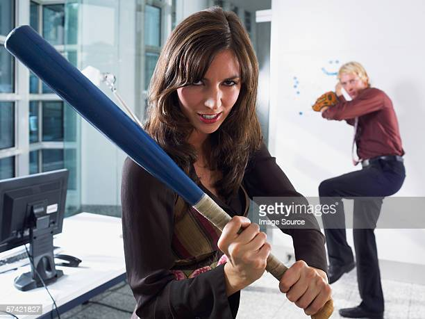 colleagues playing baseball - baseball bat stock pictures, royalty-free photos & images