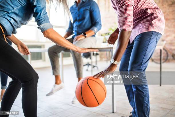 colleagues playing basketball in office - bouncing ball stock photos and pictures