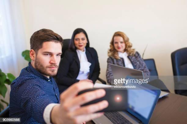 Colleagues take selfie
