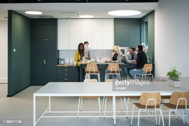 colleagues taking a break in the cafeteria - canteen stock pictures, royalty-free photos & images
