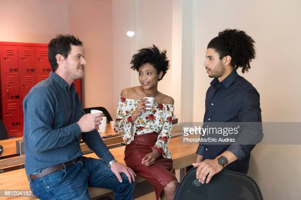 colleagues taking coffee break in breakroom - close to stock pictures, royalty-free photos & images