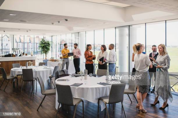 colleagues talking and waiting for lunch at corporate event - conference event stock pictures, royalty-free photos & images