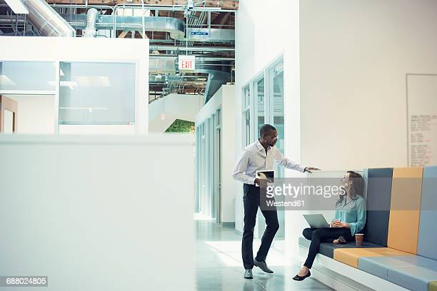 colleagues talking in corridor, using mobile devices - copy space stock pictures, royalty-free photos & images
