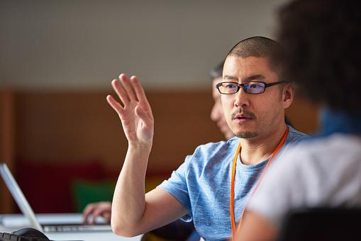 Colleagues talking in tech start-up office - gettyimageskorea