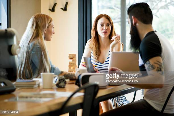 Colleagues talking together in casual office