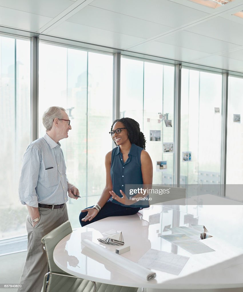 Colleagues talking together in conference meeting room : Stock Photo