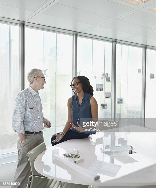 colleagues talking together in conference meeting room - idol stock pictures, royalty-free photos & images