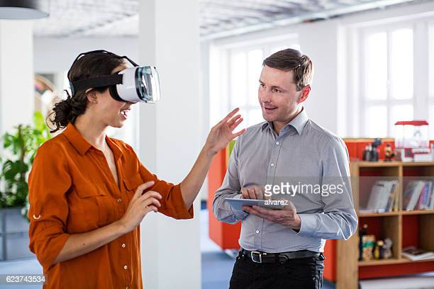 colleagues testing out virtual reality software - virtual reality simulator stock photos and pictures