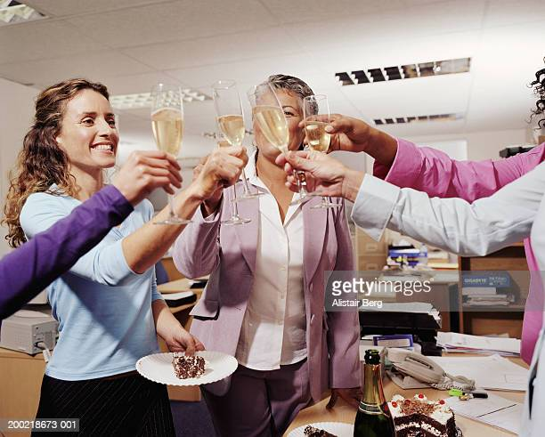 Colleagues toasting in office