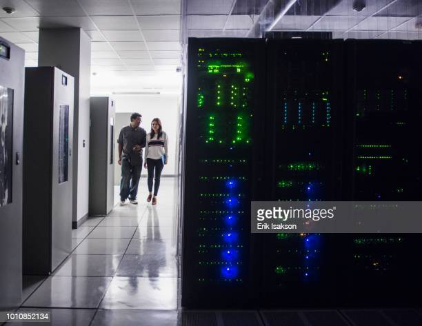Colleagues walking in server room