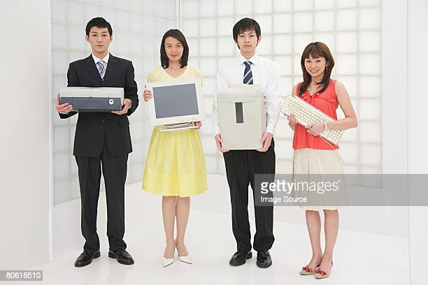 Colleagues with office equipment