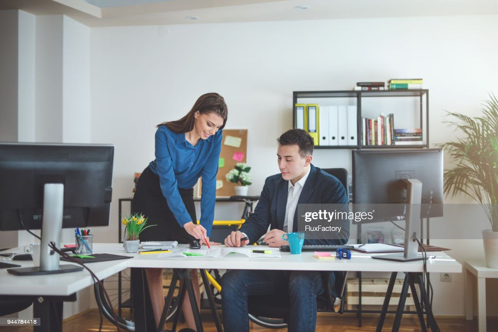 Colleagues working as one : Stock Photo