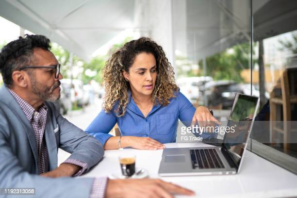 colleagues working in a cafeteria - return on investment stock pictures, royalty-free photos & images