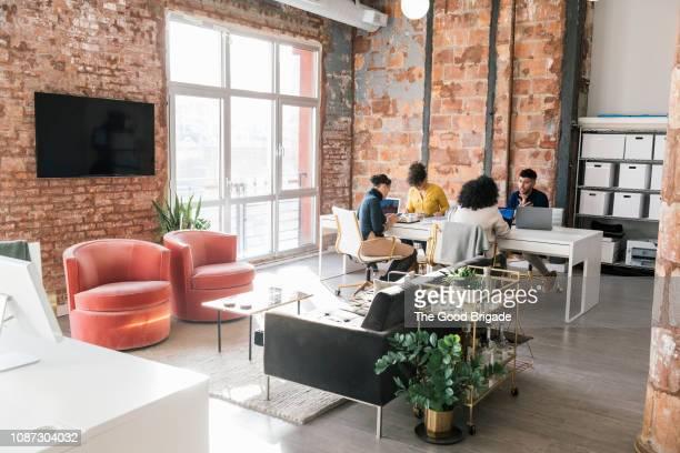 colleagues working in a modern office - new business fotografías e imágenes de stock