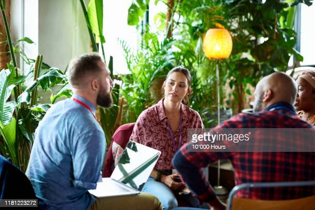 colleagues working in conference breakout group - publicity event stock pictures, royalty-free photos & images