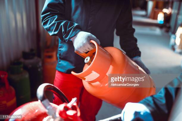 colleagues working in liquified gas store - butane stock pictures, royalty-free photos & images