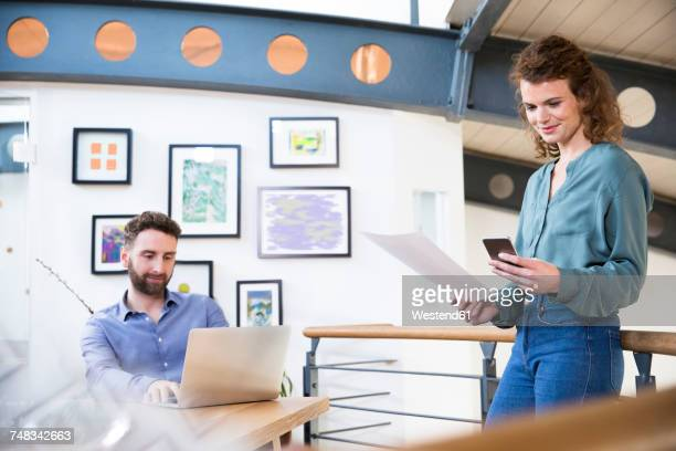 colleagues working in modern office - man made structure stock pictures, royalty-free photos & images