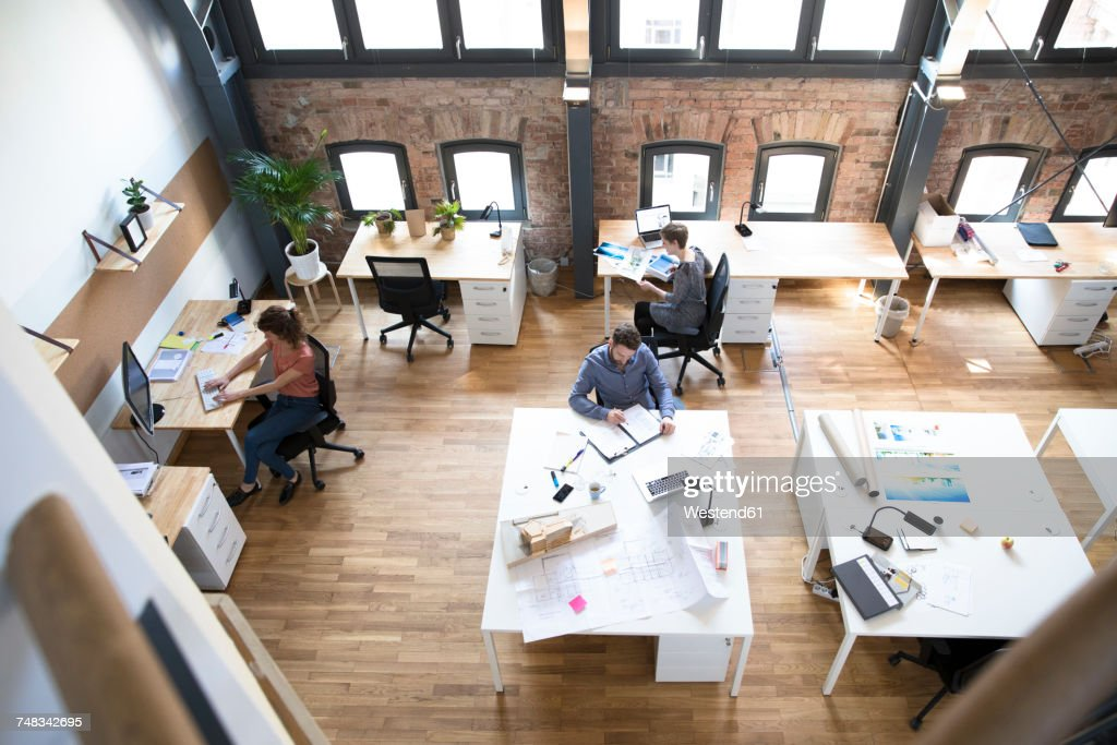 Colleagues working in modern office : Stock Photo
