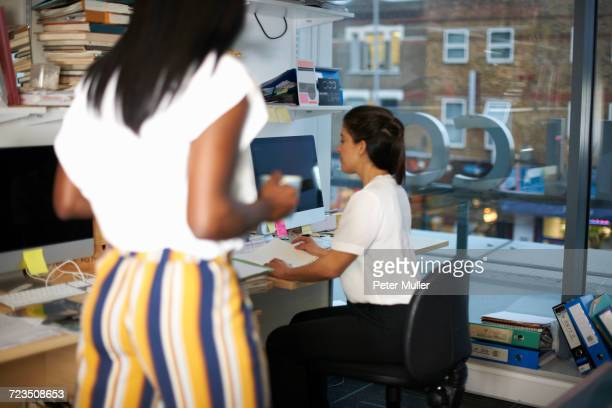 colleagues working in office - surrey england stock photos and pictures