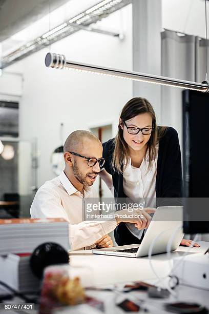 Colleagues working late in modern office