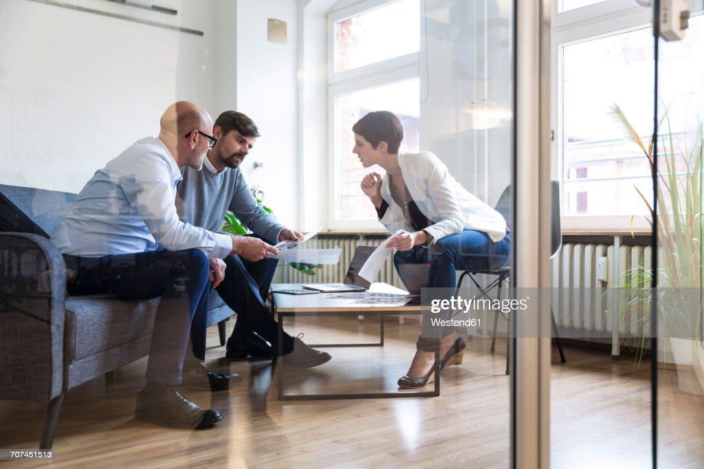 Colleagues working together in boardroom : Stock-Foto