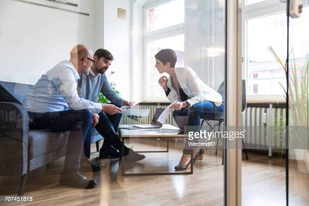 Colleagues working together in boardroom