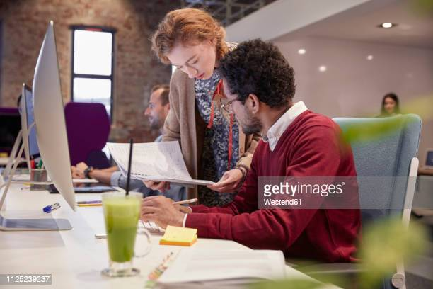 colleagues working together in office - employee appreciation stock pictures, royalty-free photos & images