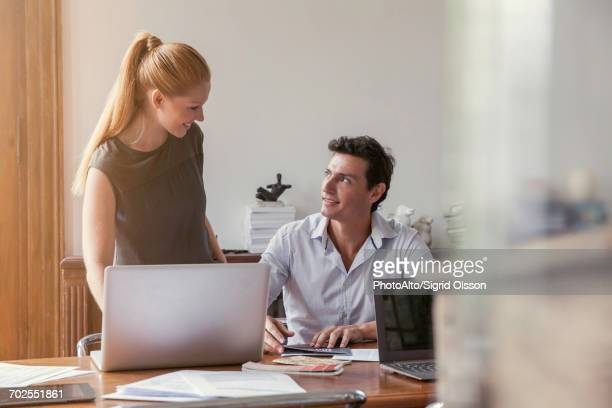 colleagues working together in office - work romance stock pictures, royalty-free photos & images