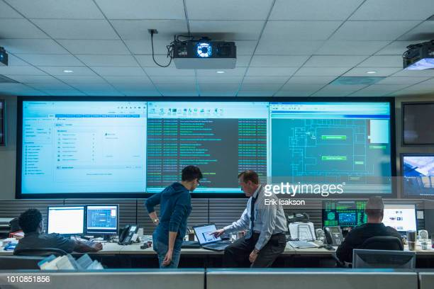 colleagues working together in server control room - data center stock pictures, royalty-free photos & images