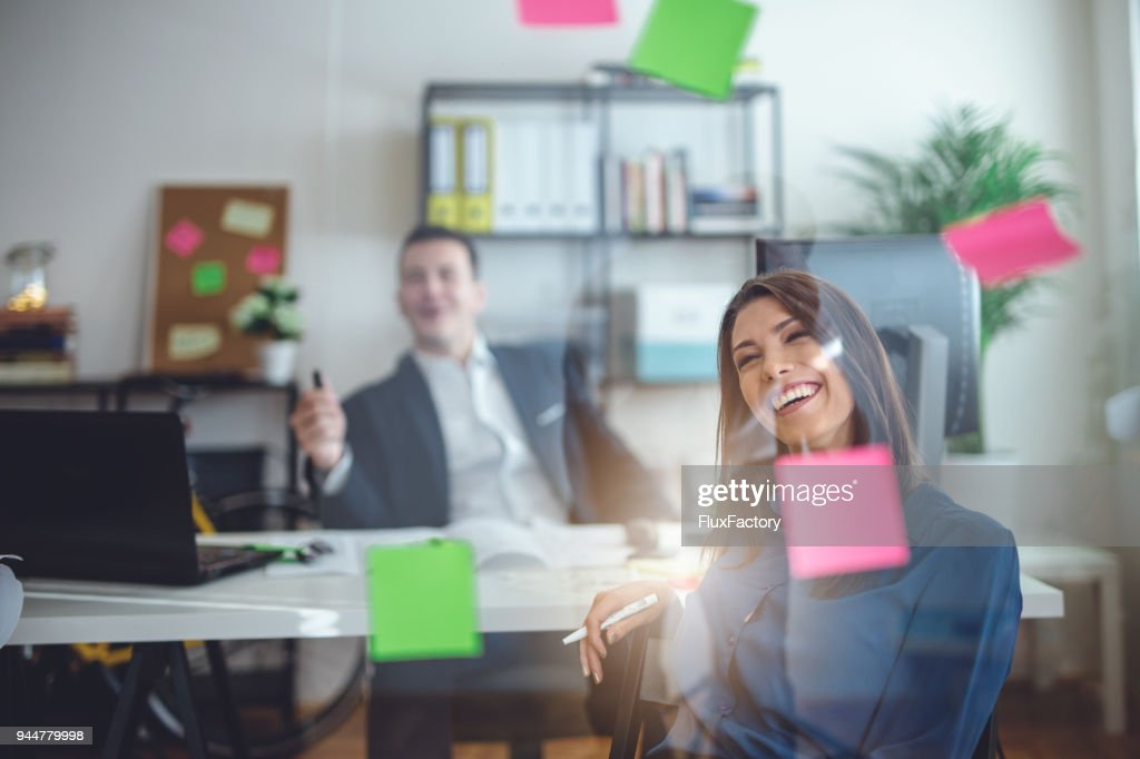 Colleagues working together in the office : Stock Photo