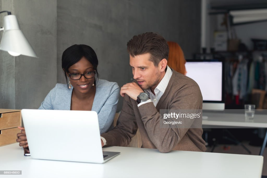 Colleagues working together : Stock Photo