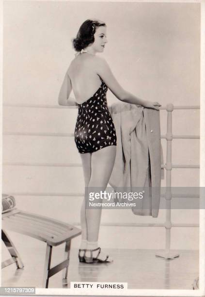 Collectible British American Tobacco Card Modern Beauties series published 1938 depicting film actress Betty Furness posing in a glamorous swimsuit...