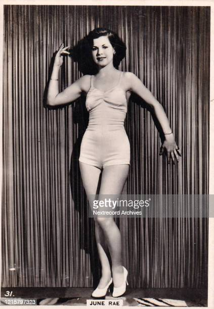Collectible British American Tobacco Card Modern Beauties series published 1938 depicting film actress June Rae posing in a glamorous swimsuit...