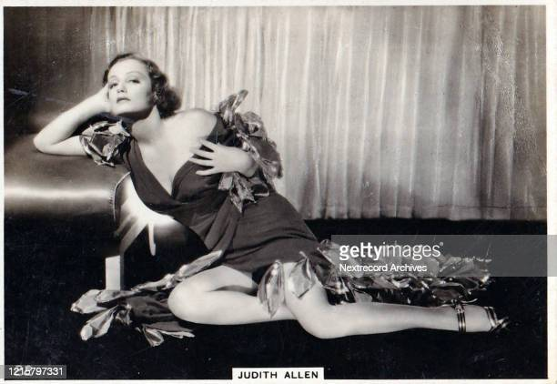 Collectible British American Tobacco Card Modern Beauties series published 1938 depicting film actress Judith Allen posed seductively in a black...