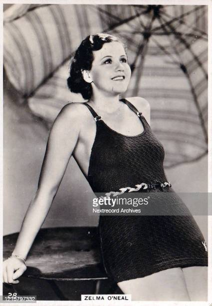 Collectible British American Tobacco Card Modern Beauties series published 1938 depicting film actress Zelma O'Neal posing in stylish swimsuit...