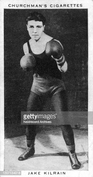 Collectible tobacco card from 1938 series titled Boxing Personalities distributed with packs of Churchman brand tobacco and cigarettes depicting the...