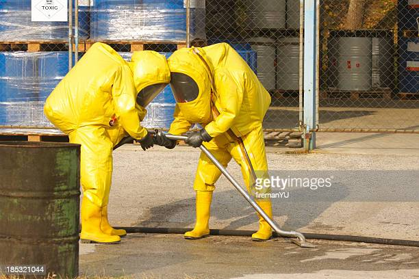 collecting dangerous goods - toxic waste stock pictures, royalty-free photos & images