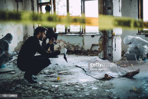 collecting evidence on a crime scene - crime scene stock pictures, royalty-free photos & images